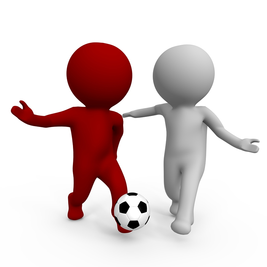 bigstock-Two-people-playing-soccer-a-7801996